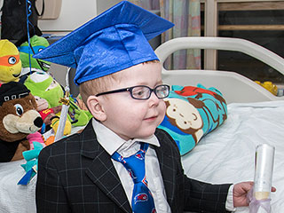 5-Year-Old Who Underwent Life-Saving Surgery Couldn't Make it to His Pre-K Graduation – So the School Brought the Ceremony to Him!