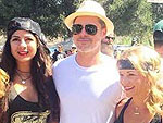 Brad Pitt Keeps It Low-Key as He Attends Motorcycle Event and Poses with a Bevy of Fans