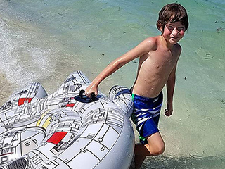 Hit the Hyperdrive! Jacob Tremblay Makes a Splash in His Signature Star Wars Superfan Style
