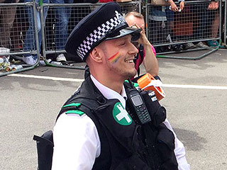 London's Pride Parade Comes to Halt as Two Police Officers Propose Marriage
