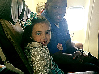 See the Touching Moment a Flight Attendant Comforts a 9-Year-Old Girl with Severe Anxiety