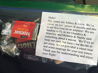 Parents Hand Out 'Twin Survival Kit' to Fellow Flyers: 'We've Provided a Sweet Treat and Some Earplugs for Your Enjoyment'