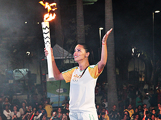Brazilian Supermodel Adriana Lima Cries with Pride as She Carries the Olympic Torch Through the Streets of Rio