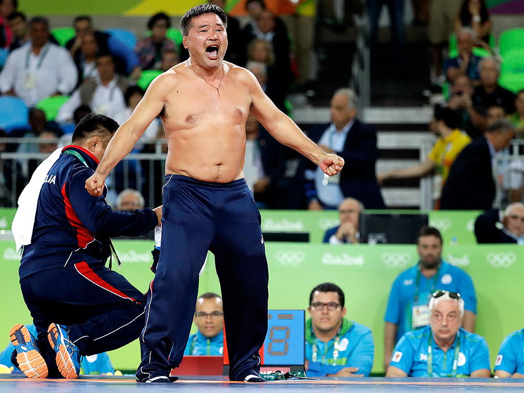 Mongolian Wrestling Coaches Rip Off Clothes in Protest After Losing ...: http://www.people.com/people/mobile/article/0,,20996464_21025694,00.html