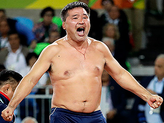 FROM SI: Mongolian Wrestling Coaches Suspended 3 Years for Stripping in Protest