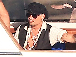 Johnny Depp Boards Yacht in Ibiza Following Divorce Settlement: Actor 'Seemed Pretty Relaxed' During Getaway, Source Says