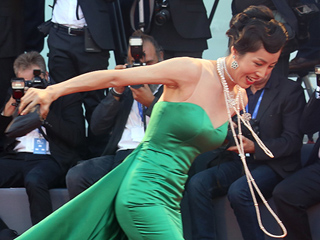 Chinese Actress Takes a Tumble on the Venice Red Carpet – but Recovers with Poise and a Smile