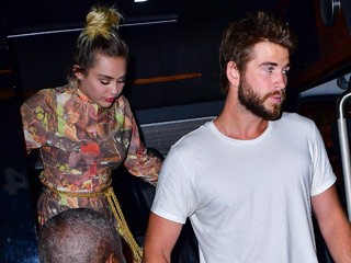 Miley Cyrus and Liam Hemsworth Lock Hands After Attending Premiere of Her New Show Crisis in Six Scenes