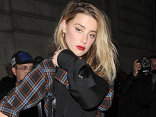 Amber Heard Parties in London with Cara Delevingne at Star-Studded Fashion Week Bash