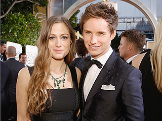 Parents-to-Be Eddie Redmayne and Wife Dazzle on the Red Carpet – and Get a Special Baby Gift from Ryan Seacrest!