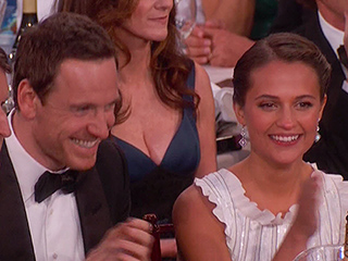 Michael Fassbender Sits with Girlfriend Alicia Vikander at Golden Globes, Making Award Show Debut as a Couple
