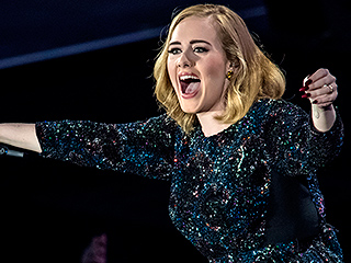 FROM EW: Adele Calls Out Fan for Filming Concert