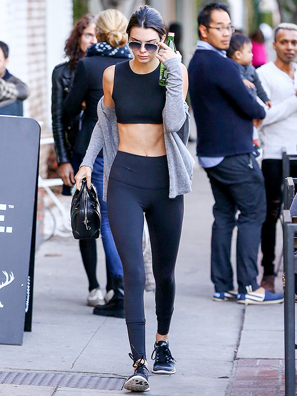 Kendall Jenner in leggings and crop top