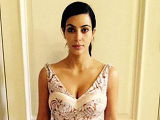 Kim Kardashian Posts Sexy Flashback Photos from Prada Fitting