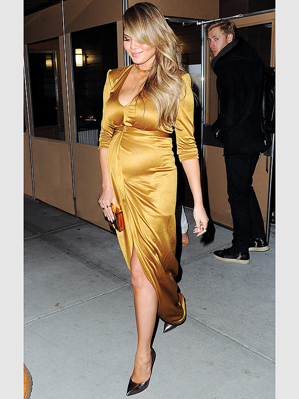 Chrissy Teigen pregnant gold dress
