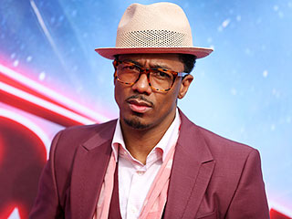 Nick Cannon's Fake Glasses Serve a Real Purpose on the Red Carpet