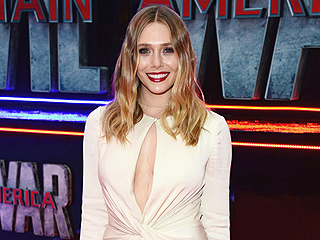 Elizabeth Olsen's Plunging Gown at the Captain America: Civil War Premiere Makes Chris Evans Literally Stop and Stare