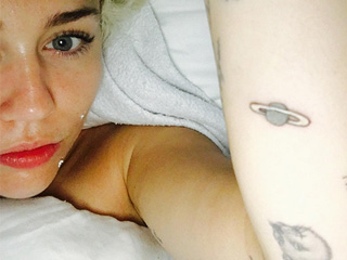 Oops! Miley Cyrus Adds a 'Jupiter' Tattoo to Her Growing Ink Collection – But Wait, It's Actually Saturn