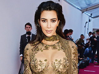 Ssssssexy! Kim Kardashian Makes Jaws Drop in Sheer, Snake-Embroidered Gown