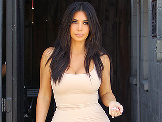 Kim Kardashian Flaunts Post-Baby Bod in (What Else?) a Tight Body Con Dress