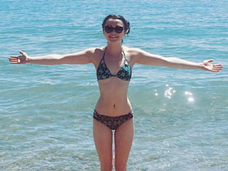 Maisie Williams Channels The Little Mermaid's Ariel 'Minus the Tail and T---s' in New Bikini Pic