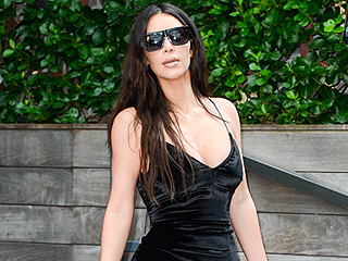 Kim Kardashian Is Going to Wear Velvet Dresses and Clear Shoes No Matter What the Weather (or How You Feel About It)