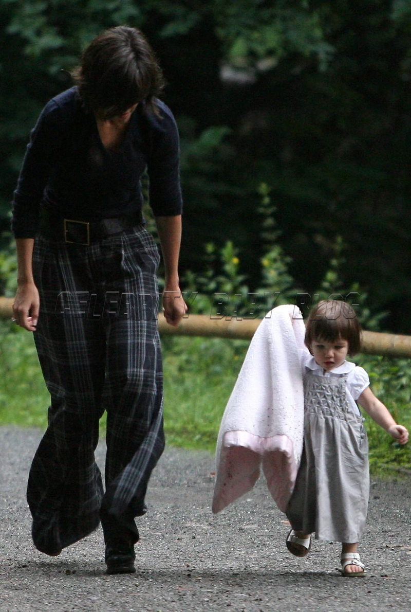 Katie Holmes And Suri Cruise Play At A Park In Germany