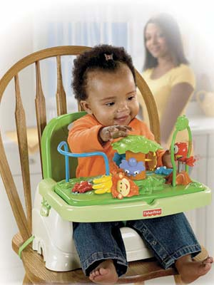 Fisher price rainforest healthy care booster seat moms for Silla fisher price para comer