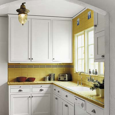 small kitchen yellow paint white cabinets
