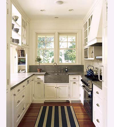 bright gallery kitchen in new Shingle-style house < >. Photo: Bruce Buck