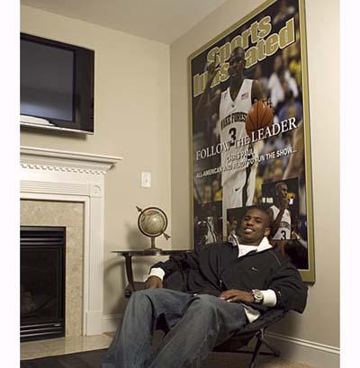 NBA star Chris Paul next to his fireplace