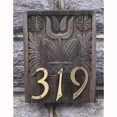 Brass numbers mounted on antique wooden mold