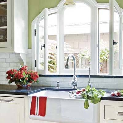 farmhouse sink in this remodeled spanish style kitchen