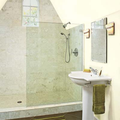 glass partition acts as a shower enclosure in this attic remodel