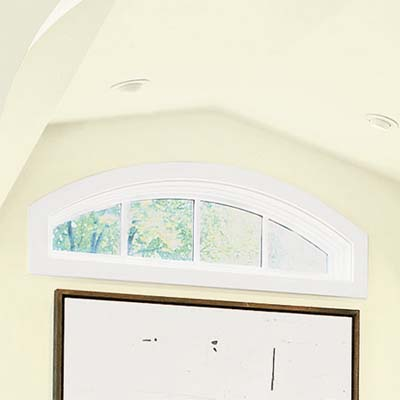 eyebrow window opens up the home office in this attic remodel