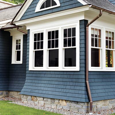 half-round copper gutters on a house with shingle siding
