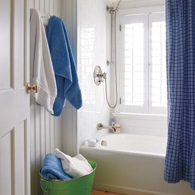 kids bathroom with beadboard walls and windowed tub