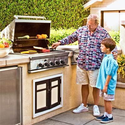 an outdoor kitchen with a gas grill