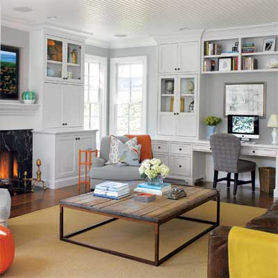 the family room in this remodeled, light-filled colonial home