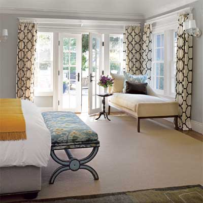 the master bedroom in this remodeled, light-filled colonial home
