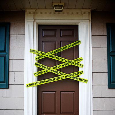 front door with yellow danger tape