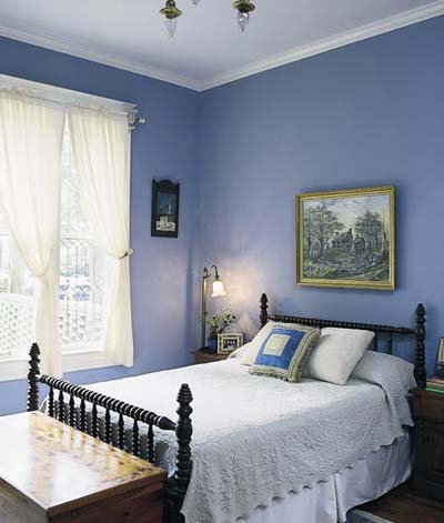 elegant bedroom dark blue painted walls decorated