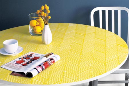 a finished table with a herringbone pattern combed onto it in yellow