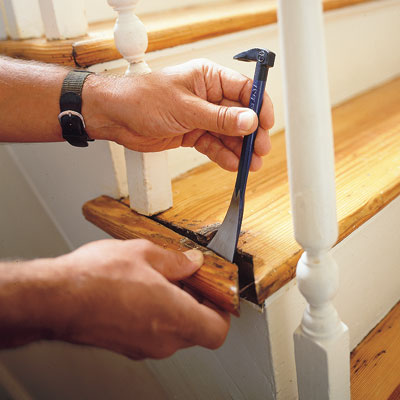 removing the end cap on a stairway with a flat pry bar