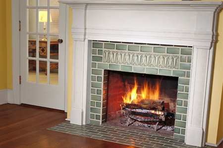 a finished tiled fireplace