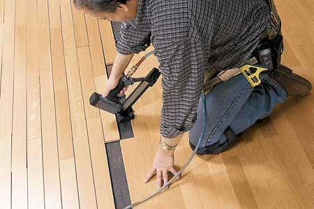 Pre-engineered hardwoods or Pergo/laminate floors? And why