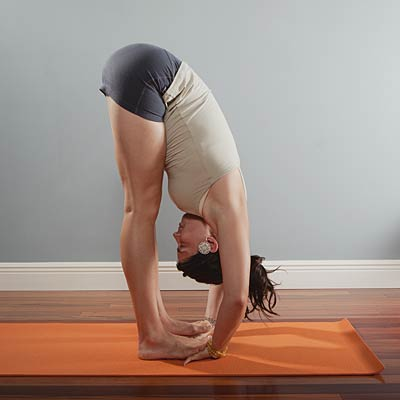 "standing forward bend or ""uttanasana""  bloated 14 yoga"